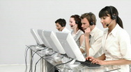 Multi-ethnic business people working in a call center Stock Footage