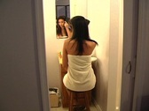 Stock Video Footage of Beautiful Young Woman in Her Bathroom Brushing Her Hair 6