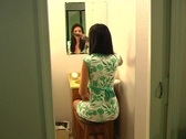 Stock Video Footage of Beautiful Young Woman in Her Bathroom Brushing Her Hair 8