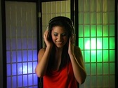 Stock Video Footage of Beautiful Young Woman Listens to Music in Her Headphones 15