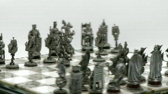 Silver chess pieces on board rotate Stock Footage