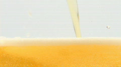 Pouring fresh beer into glass Stock Footage