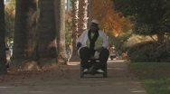 Overweight woman in wheelchair Stock Footage