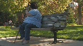 Obese woman on park bench Footage