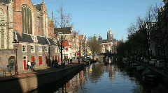 Amsterdam with Tourists along Canal Stock Footage