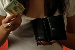 Beautiful Young Woman Puts a Twenty-dollar Bill in her Wallet (close-up) Stock Footage