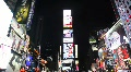 Tourists Walking in Times Square at Night Footage