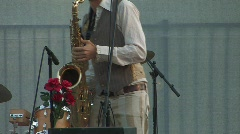 Musician playing saxaphone (editorial) - stock footage