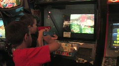 Kids playing video games Stock Footage