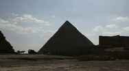 Stock Video Footage of Great Pyramid with Cars and Horse Drawn Carriage