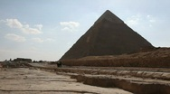 Stock Video Footage of Great Pyramid with Bus in Background