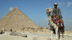 Egyptian Man on Camel in front of Great Pyramid - stock footage