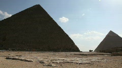 Great Pyramid with People and Cards in Background - stock footage