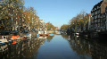 Amsterdam with Boats and Homes along Canal HD Footage