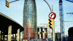 Barcelona traffic transport vehicles rush hour urban city torres agbar Stock Footage