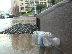 Plastic bottle in storm drain near Cannery Row Stock Footage