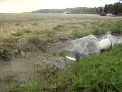 Plastic bag floating in run off. Stock Footage