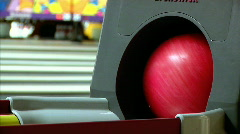 Pink and Green Bowling Balls are Returned in the Ball Return Stock Footage