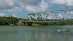 Metal bridge stretching over the Loboc river on Bohol Philippines Stock Footage