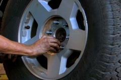 Mechanic replacing lug nuts on wheel Stock Footage