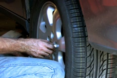 Mechanic replacing wheel on car Stock Footage