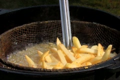Cooking french fries at an outdoor picnic Stock Footage