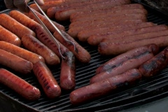 Hot dogs cooking on an outside grill Stock Footage