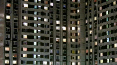 Multi-story housing at late evening with windows lighting 2, HD Stock Footage