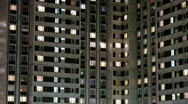 Stock Video Footage of Multi-story housing at late evening with windows lighting 2, HD