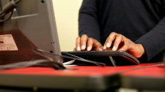 African American using keyboard Stock Footage