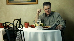 Man eating in a restaurant Stock Footage