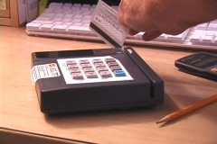 Credit / debit card swipe through terminal - stock footage