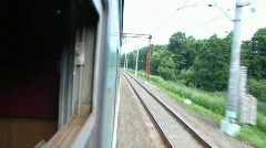 View from train going on country, camera comes out and back Stock Footage