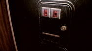 Dropping money into coin slot (sound) Stock Footage