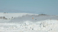 Snow blow over mountainside P HD 6327 Stock Footage
