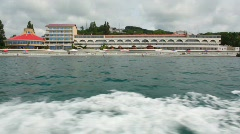 View on health resort in sea shore from going cutter Stock Footage