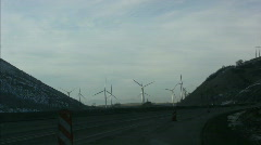 Eco Friendly Windmills Turn in the Wind Creating Energy Stock Footage
