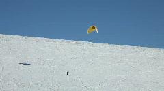 Snowkite climbing steep mountain P HD 6291 Stock Footage