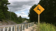 Stock Video Footage of Caution! Deer sign. Two shots.