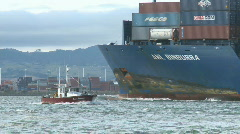 Container ship and fishing boat pass bow Stock Footage