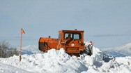 Snow plow caterpillar backing in snow P HD 6300 Stock Footage