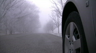 Stock Video Footage of Silver Car is about to Drive Down a Foggy Scary Cold Road