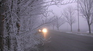 Stock Video Footage of Red Car Drives Down a Scary Foggy Road on a Cold Wet Day