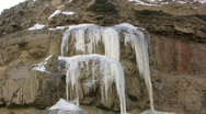 Stock Video Footage of Ice cycles dripp down a huge frozen waterfall