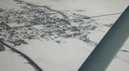Town in snow covered valley aerial shot P HD 6358 Stock Footage