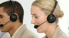 Multi-etnic business team working in a call centre - stock footage