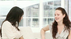 Lively business women talking sitting on sofa Stock Footage