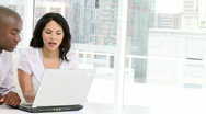 Cheerful business peole working at a computer Stock Footage