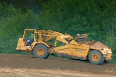 Heavy equipment work on highway construction  Stock Footage