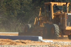Scraper and heavy equipment work on a construction site - stock footage